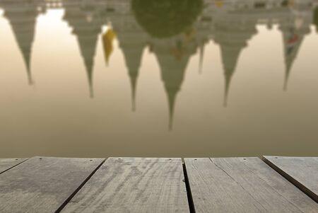 samutprakarn: Defocus and blur image of terrace wood and Reflect of Ancient pagoda at Wat asokaram of Samutprakarn Province Thailand for background usage