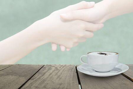 shaking out: Defocus with terrace wood and cappuccino coffee with fade out of Business people shaking hands for background usage Stock Photo