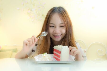 Beautiful girl eating cake in coffee shop photo