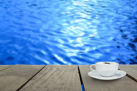 veranda wood and coffee inside river Blur background photo