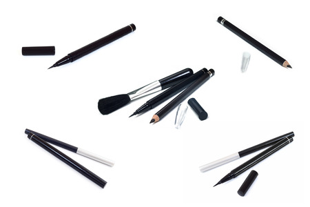 smeared mascara: Collection of cosmetics makeup Eyeliner Black pencil eye liner and Brush on