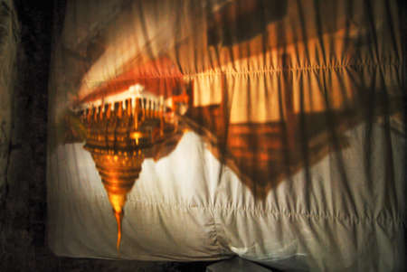 unseen: Unseen Thailand ,Flip vertical Pagoda from Lighting reflect to curtain in Lampang ,Thailand Editorial
