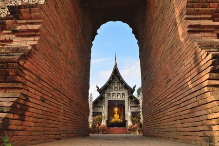 architech: Beautiful temple in Thailand. Looking under Architech brick wall in Wat Lok mo lee Chiangmai Thailand