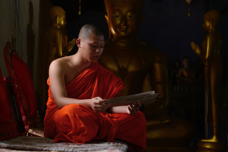 chant: CHIANGMAI, THAILAND - OCT 1 2015 : Everyday very early in the morning, Monk chant mantra in front of buddha in Chiangmai, Thailand Editorial