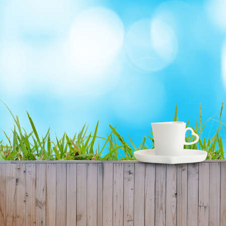 fence: Coffee cup put on fence as background texture