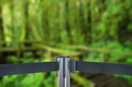 barricade: Barricade with green forest (do not entry) as blur background Stock Photo