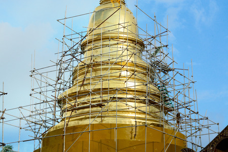 scaffold: Scaffold structure in construction site between renovate golden pagoda in Chiangmai Thailand