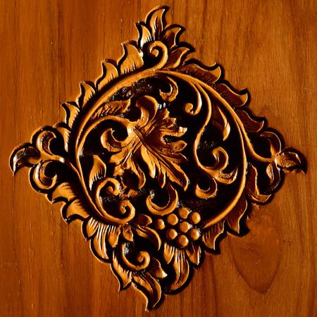 teakwood: Beautiful symbol leaves carving on teakwood Stock Photo