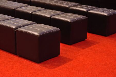red carpet background: Beautiful sofa on red carpet for background