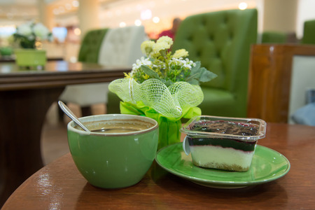 espreso: Cup of art espresso and cake on desk