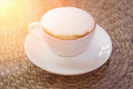 mellow: A cup of cappuccino in vintage and light leak color style