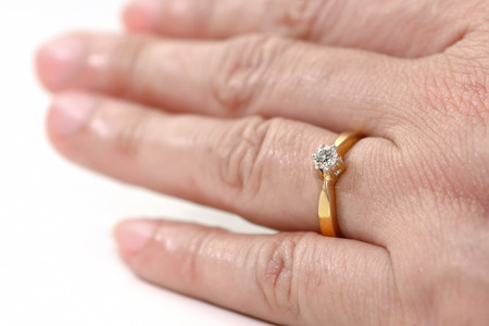 ring finger: Diamond ring E color of HRD in ring finger Stock Photo