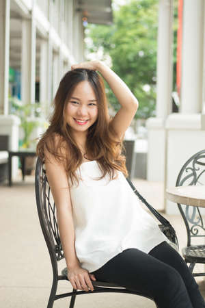 raise hand: Asian beautiful girl raise hand higher and put hand over head and smile Stock Photo