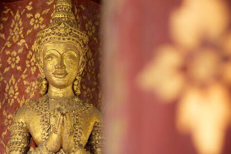 pra: Golden ancient sculpture in Wat Pra Singh Temple pavilion  ,Chiangmai ,Thailand