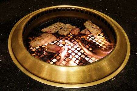 Food on Korean barbecue grill (Korean BQQ) Stock Photo