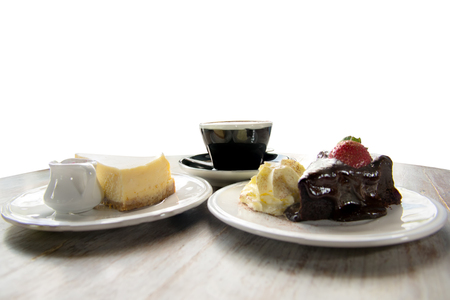 flourless chocolate cake: Flourless Chocolate Cake with strawberry ,Cheese pie cake and coffee as background