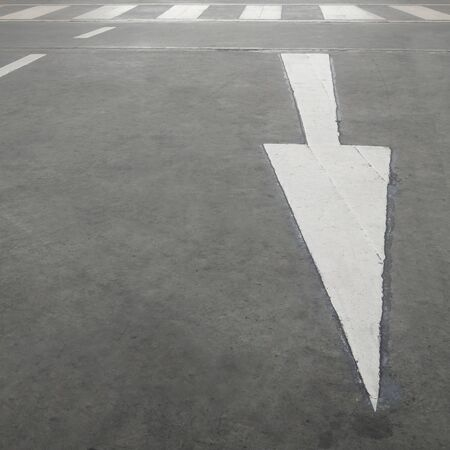 road surface: Asphalt road and arrow sign on surface