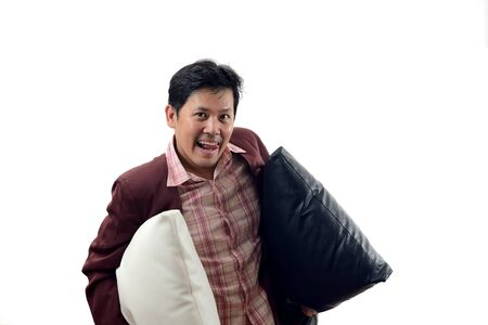 Asian crazy Businessman holding pillow and prepare go to bed isolate on white background 版權商用圖片