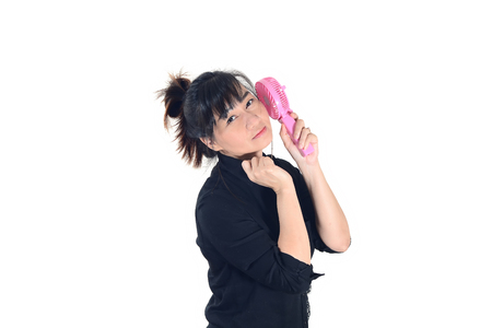 Asian woman cools herself with a handheld portable fan and looking at camera isolate on white background