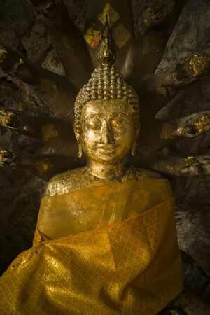 Ancient Golden Seated Buddha ,Buddha Sheltered by Naga Hood Editorial