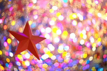Red star over colorful bubble bokeh as christmas background Stockfoto