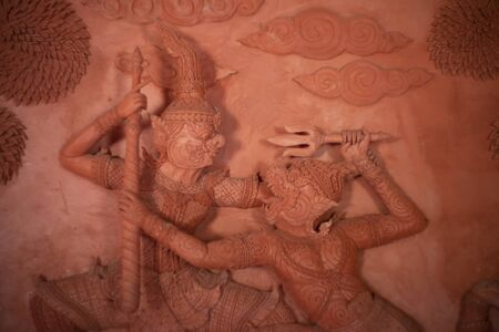 Hanuman monkey god fighting Thotsakan giant stucco tracery sculpture public place in thialnd temple, Based on the character in Ramakien or Ramayana Literature