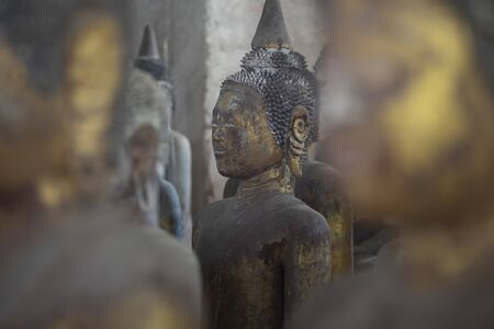 Ancient Coral reef Buddha state at public place in Thailand temple. Beautiful buddha state made from coral reef stone unseen in Thailand