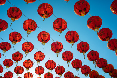 chinese lanterns: chinese lanterns over clear blue sky