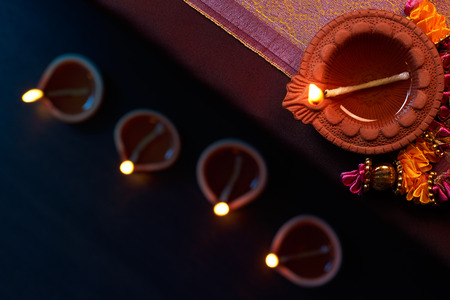 floor lamp: Traditional clay diya lamps lit during diwali celebration