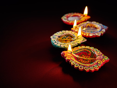 oil lamp: Colorful clay diya lamps lit during diwali celebration