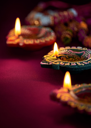 culture decoration celebration: Colorful clay diya lamps lit during diwali celebration