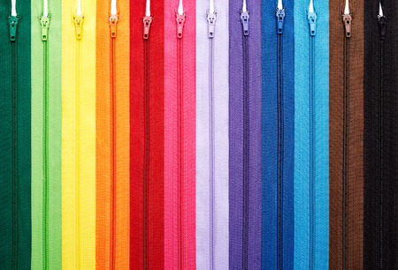 Colorful zipper collection in vertical arrangement isolated