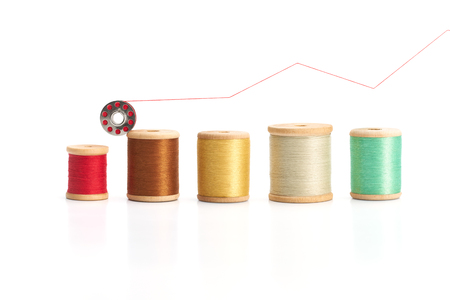 bobbin: Bobbin thread forming a graph chart on white background Stock Photo