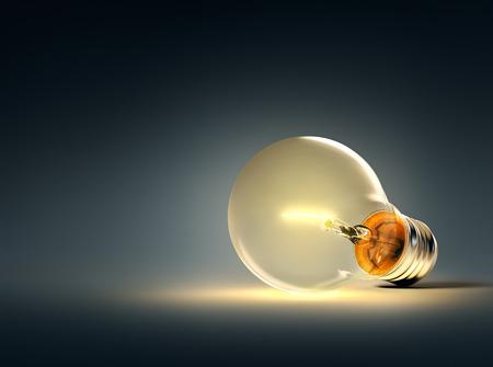 glowing light bulb: Glowing light bulb on a blue background