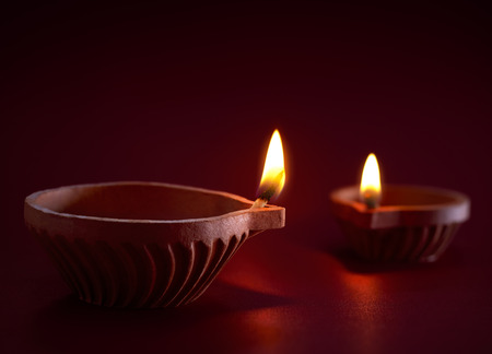 red oil lamp: Traditional clay diya lamps lit during diwali celebration