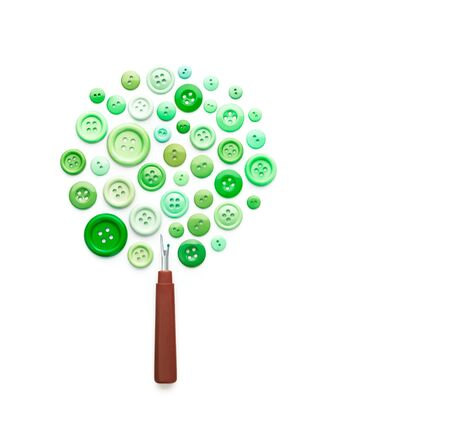 ripper: Tree made of sewing buttons and ripper isolated on white background