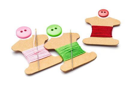 sewing buttons: Needle, thread, sewing button and kraft card bobbin