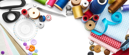 sewing tools: Overhead view of sewing tools and accessories on white background Stock Photo