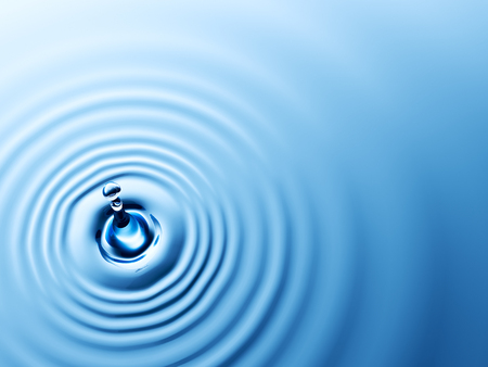 Top view of a water drop with ripples