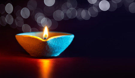 Traditional clay diya lamps lit during diwali celebration Stock Photo - 45841682