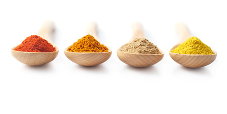 Wooden spoon filled with spice powders on white background Imagens - 46406991