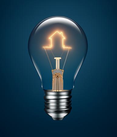 ahorros: Bombilla con el filamento de la formación de un icono de la casa en fondo azul