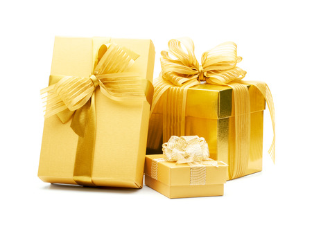 present: Golden gift boxes with ribbon on white background Stock Photo