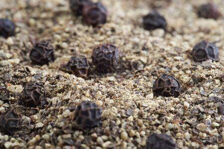 peppercorns: Close up black peppercorns and ground pepper