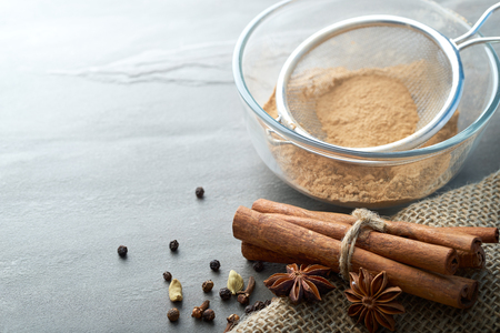 burlap sack: Spices and burlap sack on a slate counter with copyspace Stock Photo