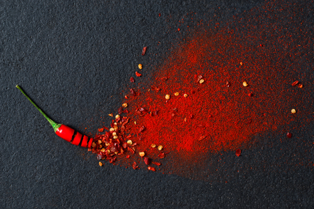 spice: Chilli, red pepper flakes and chilli powder burst Stock Photo