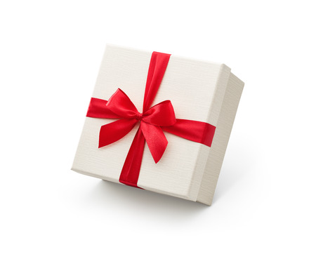 White gift box with red bow isolated on white background - Clipping path included Zdjęcie Seryjne