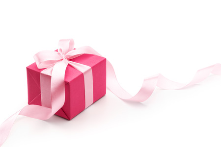 Pink gift box with ribbon isolated on white background