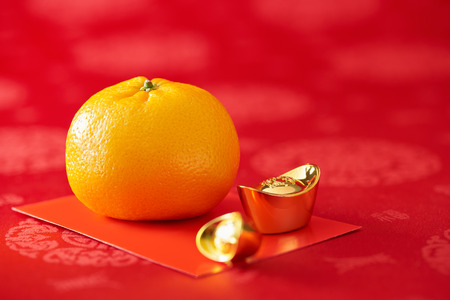 Chinese New Year - Mandarin orange, gold sycee and red packet