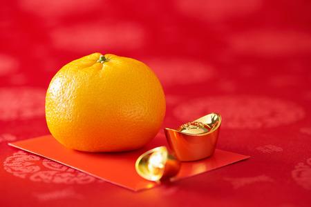Chinese New Year - Mandarin orange, gold sycee and red packet